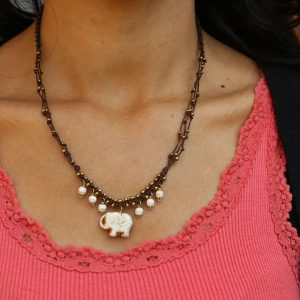 Multiline White Howlite Elephant Necklace on braided brown cord 17""