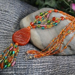 "Multiline Orange and Mix Color Glass bead necklace. The 2"" Orange Glass Teardrop pendant tops a 5"" center drop; Hook and Eye Clasp 27.5"""
