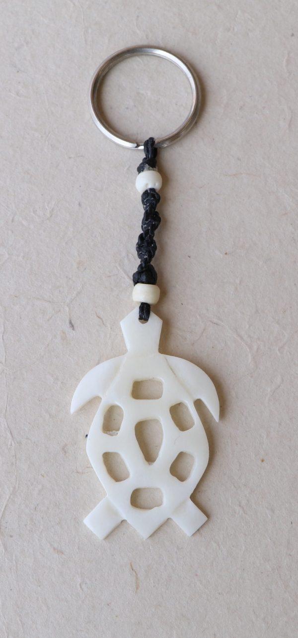 White bone turtle with holes pendant